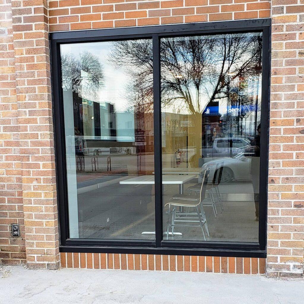 Storefront window installation in Winnipeg